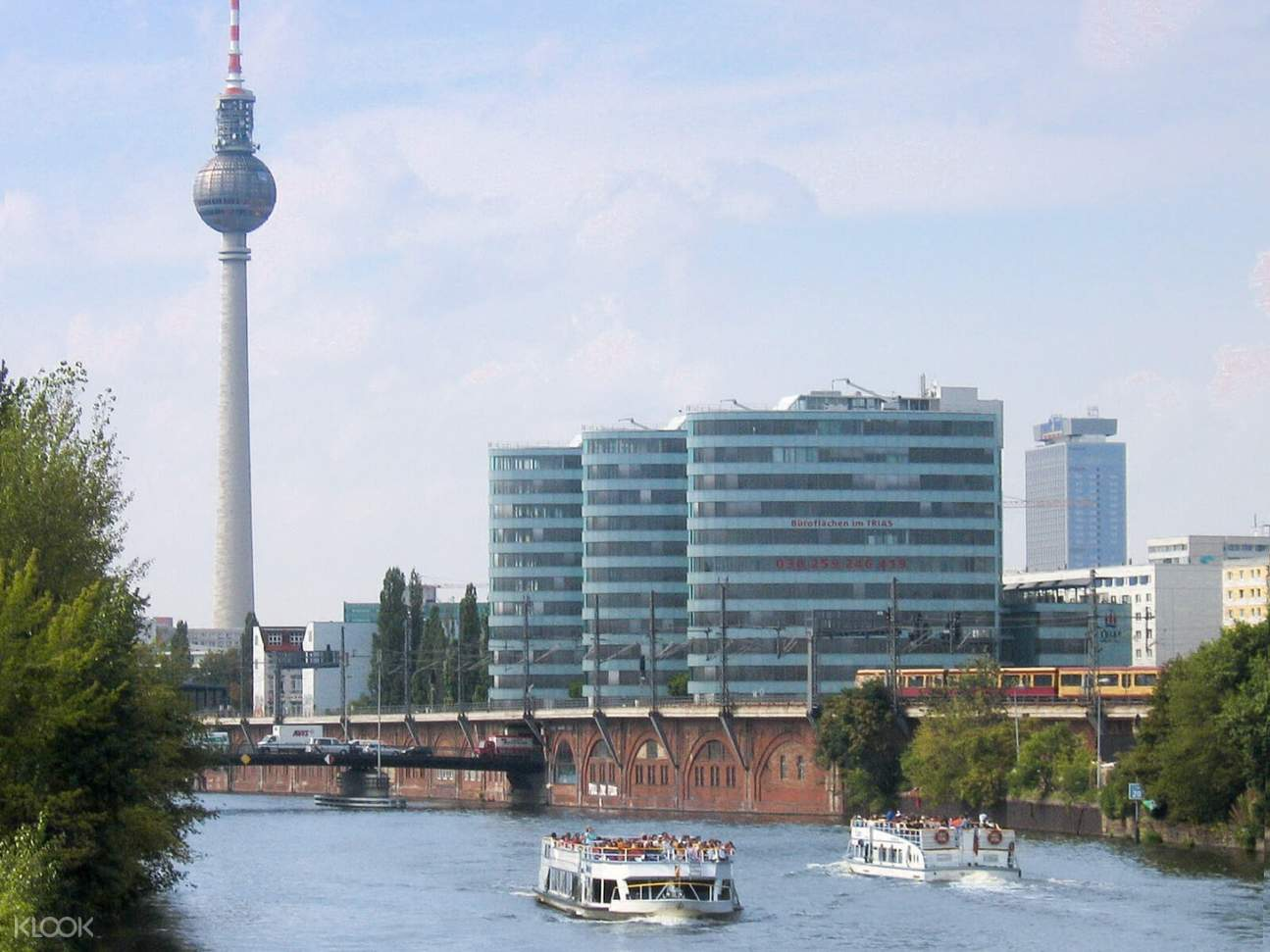 hop-on hop-off sightseeing boat passing by berlin tv tower